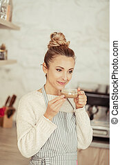 Beautiful woman holding her cup of coffee.
