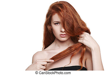 Beautiful woman holding her red hair in hand