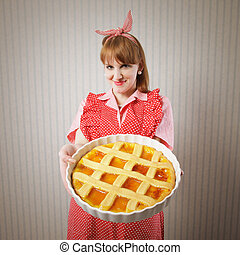 Beautiful woman holding italian pie. - Retro housewife...