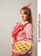 Beautiful woman holding italian pie.