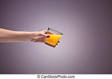 beautiful woman holding orange juice