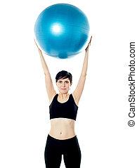 Beautiful woman holding pilates ball
