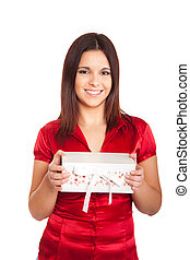 Beautiful woman holding presents while smiling