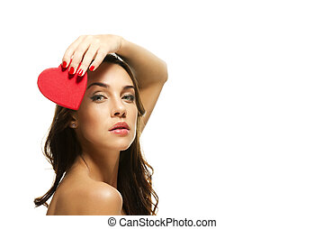 beautiful woman holding red heart over her head on white background