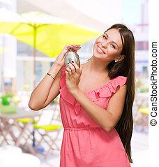 Beautiful Woman Holding Shaker