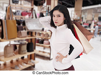 woman holding shopping bag at mall