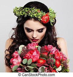 Beautiful Woman holding Summer Flowers