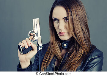 beautiful woman holding up her weapon