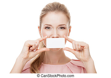 Beautiful woman holding white card at front of her lips with cop