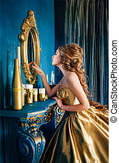 Beautiful woman in a ball gown - Beautiful woman in a golden...