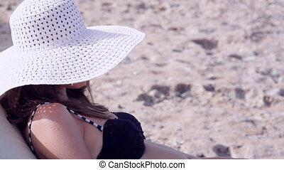 beautiful woman in a big white hat