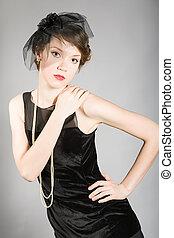 woman in a black dress retro
