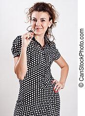 beautiful woman in a black polka dot dress