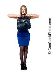 Beautiful woman in a blue dress with a black handbag