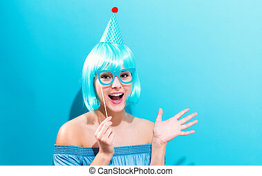 Beautiful woman in a bright blue wig