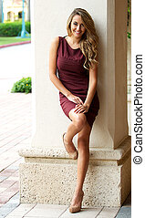 Beautiful woman in a burgundy colored dress.