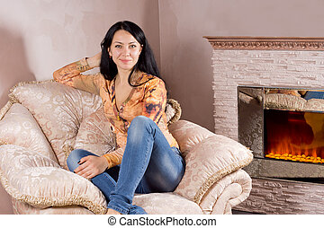 Beautiful woman in a comfortable armchair