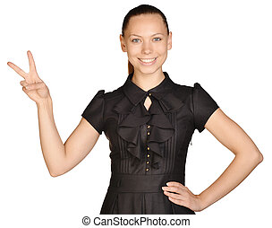 beautiful woman in a dress showing victory gesture.