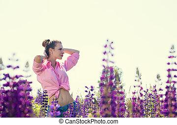 Beautiful woman in a field of flowers