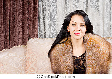 Beautiful woman in a fur collar