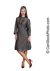 Beautiful woman in a gray dress