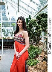Beautiful woman in a greenhouse