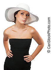 Beautiful woman in a hat looking at camera