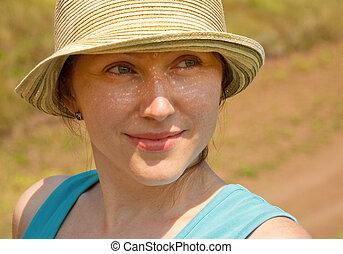 Beautiful woman in a hat