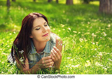 Beautiful woman in a meadow