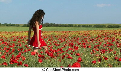 Beautiful woman in a poppy field