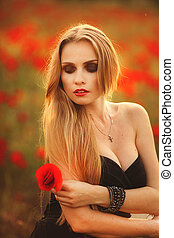 Beautiful woman in a poppy field