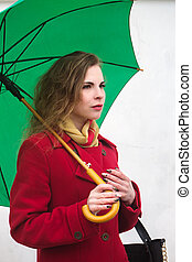 Beautiful woman in a red coat