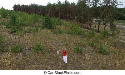 beautiful woman in a red shirt walk