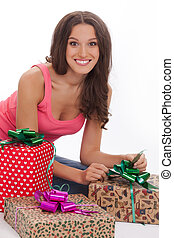 beautiful woman in a red vest and blue jeans enjoys gift on Valentine's day