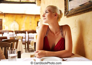 Beautiful woman in a restaurant