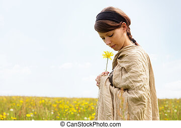 Beautiful woman in a romantic wildflower meadow