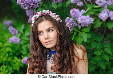 beautiful woman in a spring park Lilac