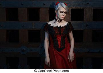 Beautiful woman in a vintage dress.