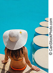beautiful woman in a white hat