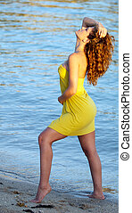 Beautiful woman in a yellow dress.