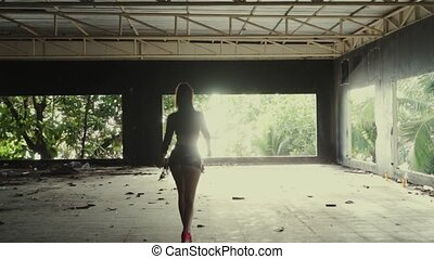 Beautiful woman in abandoned building