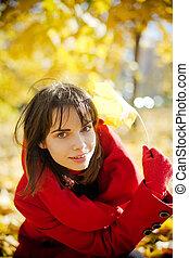 Beautiful Woman In Autumn Park