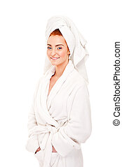 Beautiful woman in bathrobe smiling