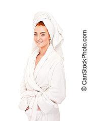 Beautiful woman in bathrobe smiling