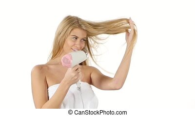 beautiful woman in bathroom drying hair with blow dryer. Close up, slow motion, bathroom