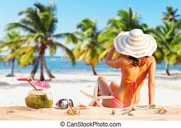 Beautiful woman in bikini at the seaside