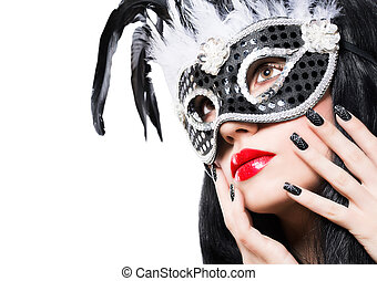 Beautiful woman in black carnival mask with manicure