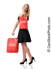 Beautiful woman in black dress with sale bags
