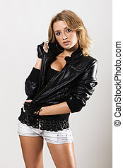 Beautiful woman in black leather jacket