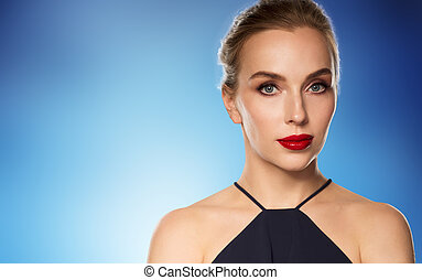 beautiful woman in black over blue background